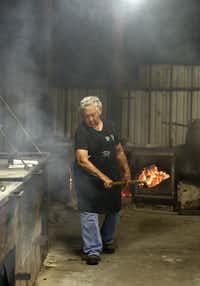 "Tootsie Tomanetz makes her way between pits, hauling hot coals at Snow's BBQ in Lexington, on Saturday, Aug. 11. Tomanetz begins work at 2 a.m. on Saturdays.&nbsp;(Vernon Bryant/<p><span style=""font-size: 1em; background-color: transparent;"">Staff Photographer</span></p>)"