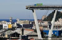 A view of the Morandi highway bridge that collapsed in Genoa, northern Italy, on Wednesday, Aug. 15. A large section of the bridge collapsed over an industrial area during a sudden and violent storm, leaving vehicles crushed in rubble below.(Antonio Calanni/The Associated Press)