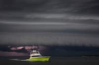 A boat heads for the safety of Dennis Dryer Municipal Harbor in late July as a fast-moving storm approaches Port Aransas on the Texas Gulf Coast.(Smiley N. Pool/Staff Photographer)