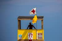"""<p>A beach guard looks out from a tower along Port Aransas Beach. Officials say d<span style=""""font-size: 1em; background-color: transparent;"""">ay-trippers driving from as far away as San Antonio have sustained the town as it recovers from the devastation wrought when Hurricane Harvey hit the Texas Gulf Coast in August 2017.</span></p>(Smiley N. Pool/Staff Photographer)"""