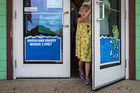 Signs on the front door at Winton's Island Candy in Port Aransas show how high the storm surge rose when Hurricane Harvey hit the Texas Gulf Coast city in August 2017.(Smiley N. Pool/Staff Photographer)