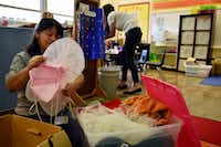 Teacher assistants Alicia Leon (left) and Lyndsey Patman prepare a shared classroom by digging through boxes of costumes for the first day of school at Terrance Elementary on Thursday in Richardson.  The assistants work in the preschool program for children with disabilities. (Ben Torres/Special Contributor)
