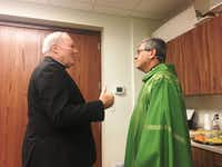 """Dallas Bishop Edward Burns and the Rev. Martin Moreno, pastor at St. Cecilia Catholic Church, discussed talking to parishioners about the church's former pastor, Edmundo Paredes, who was accused of molesting three teenage boys more than a decade ago.(<p><span style=""""font-size: 1em; background-color: transparent;"""">Rudolph Bush</span></p>/Staff)"""