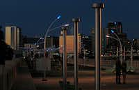 <p>Blue LEDs sit atop the streetlights around the Trinity River at the Ronald Kirk Pedestrian Bridge in downtown Dallas.</p>(Louis DeLuca/Staff Photographer)