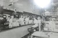 Just before the lunch rush, sometime in the late 1940s, at the Highland Park Pharmacy, located on Knox Street in Dallas.