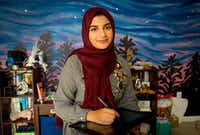 Aaliya Jaleel at home in Richardson, in front of the mural she painted on her wall.(Robert W. Hart/Special Contributor)