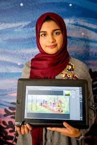 """<p><span style=""""font-size: 1em; background-color: transparent;"""">Aaliya Jaleel poses with a tablet displaying her work from </span><em style=""""font-size: 1em; background-color: transparent;"""">Under My Hijab.</em></p>(Robert W. Hart/Special Contributor)"""