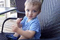 Police say 16-month-old Ashton Ness was slammed onto the sidewalk by his father, who then stabbed his son to death. A neighbor shot the father in the leg to stop the attack.'(GoFundMe)