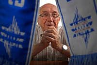 "Max Glauben, a Holocaust survivor, with a ""March of the Living"" scarf at his home in Dallas on Aug. 14, 2017.(Jae S. Lee/Staff Photographer)"