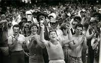 Supporters applaud a speaker in Lee Park after the pride parade on June 19, 1983.(Carlos Osorio/The Dallas Morning News)