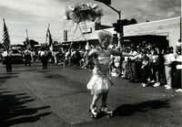 """Mitzi' skates down Cedar Springs Road during the 12th annual gay and lesbian parade in Oak Lawn on Sept. 22, 1991.(Milton Hinnant/The Dallas Morning News)"