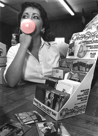 <p>Lyddie Cooper, 20, cashier at Peaches Records blows bubbles and waits for costumers - Sept 1980</p>(<p>Editorial Illustration by Meredyth Grange & Original Photo by Eliot Kamenitz</p>/DMN)