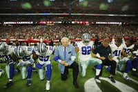 "<p>Dallas Cowboys owner Jerry Jones (center) and&nbsp; head coach Jason Garrett knelt with the team before the national anthem last September at a game in Arizona against&nbsp; the Cardinals. Now, he says the<span style=""font-size: 1em; background-color: transparent;"">&nbsp;Cowboys will require players to ""stand during the anthem, toe on the line.""&nbsp;</span></p>(File Photo/Staff)"