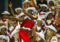 Cedar Hill High School Highsteppers drill team member George Lander Jr. (center), 16, did a dance for other members of the squad during Cedar Hill High's football game against Burleson High School in 2003.(2003 File Photo/Staff)
