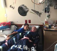 Jacob Sauceda (right) and his twin brother, Nathan, share some time together in Jacob's hospital room. Jacob was diagnosed with Burkitt's lymphoma this spring.(Wendy Sauceda)