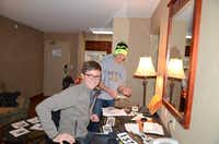 Jon helping prepare athlete bibs for a high school cross country race in 2014.(Kraig Lungstrom)