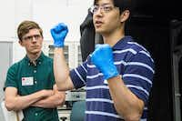 Jon Lambert (left) of The Dallas Morning News listens to Southern Methodist University graduate student Jung Soo Lee speak during Science in the City at SMU in Dallas on June 2, 2018.(Carly Geraci/Staff Photographer)