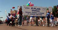 Members and supporters of Parents, Families & Friends of Lesbians and Gays (PFLAG) show their  support during the Gay Pride Parade on Sept. 29, 1996. The parade ran down  Cedar Springs Road and ended with activities in Lee Park. (The Dallas Morning News)