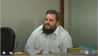 A screen shot of state Rep. Jonathan Stickland, R-Bedford, as he questioned witness Anita Hamilton at a recent hearing in Houston. Hamilton got taken by a contractor. Stickland said government should not get involved in regulation.