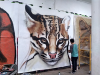 "<p><span style=""font-size: 1em; background-color: transparent;"">An ocelot is featured on a new mural in El Paso depicting endangered borderland wildlife. Ivan Melendez of Ciudad Juárez was one of four artists who worked on the piece, which is part of a national mural project. (Courtesy of Roger Peet)</span><br></p><p></p>"