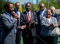 U.S. Secretary of Housing and Urban Development Ben Carson (center) applauds as Troy Broussard, president and CEO of the Dallas Housing Authority, speaks during a tour of the Dallas Housing Authority's Major League Baseball Youth Academy as part of his Listening Tour in Dallas on Thursday, March 30, 2017 at Field of Dreams Youth Mentorship Facility in West Dallas.(Ashley Landis/Staff Photographer)