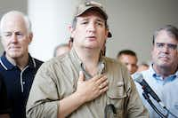 U.S. Sen. Ted Cruz is surrounded by fellow lawmakers and law enforcement as he addresses a press conference at the evacuation center at NRG Center on Monday, Sept. 4, 2017, in Houston. A group of elected officials met with evacuees and held a brief news conference to express support for emergency aid for Hurricane Harvey victims.(Smiley N. Pool/Staff Photographer)