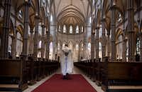 """<p>Father Kris Stubna walks through the sanctuary after a recent Mass to celebrate the Assumption of the Blessed Virgin Mary at St. Paul Cathedral, the mother church of the Pittsburgh Diocese. The diocese was among six in Pennsylvania named in a grand jury report detailing accusations against over 300 """"predator priests.""""</p>(Jeff Swensen/Getty Images)"""