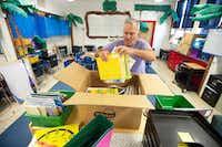 Teacher Bryan Matzke unpacks boxes of books inside his first-grade classroom at Thomas J. Rusk Elementary School in Nacogdoches on Aug. 8.(Tim Monzingo/The Associated Press)