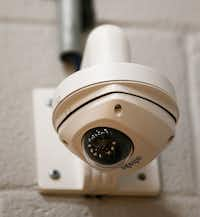 A security camera is posted in one of the gyms at Scott Johnson Middle School in McKinney.(Vernon Bryant/Staff Photographer)