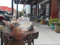Downtown Pawhuska is a working cowboy town where saddles can be found for sale along the sidewalks along with boots, lariats and spurs.(Mike Coppock/Special Contributor)