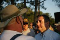 Texas senator Ted Cruz speaks to a mourner during a vigil along Avenue M and Highway 6 following a shooting at Santa Fe High School in Santa Fe, Texas May 18, 2018. 10 people  were killed and 10 others injured after a shooting at the school Friday morning. Dimitrios Pagourtzis was booked into the Galveston County Jail on capital murder charges. (Andy Jacobsohn/Staff Photographer)