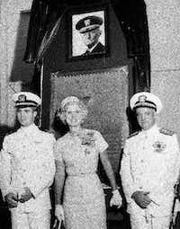 In this July 14, 1961, photo Lt. John McCain III (left) and his parents, Rear Admiral John S. McCain Jr. and Roberta Wright McCain, take part in the ceremony to commission McCain Field, the U.S. Navy training base in Meridian, Miss., named in honor of Admiral John S. McCain, in photo at top.(The Associated Press)