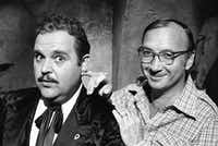 In this July 2, 1977, file photo, playwright Neil Simon (right) poses for a photo on the set of <i>The Cheap Detective </i>with Dom DeLuise.(The Associated Press)