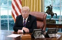 President Donald Trump talks to Mexican President Enrique Pena Nieto during a phone conversation on Monday, Aug. 27, 2018 to announce the United States-Mexico Trade Agreement in the Oval Office of the White House in Washington, D.C. (Olivier Douliery/Abaca Press/TNS)(Olivier Douliery/TNS)