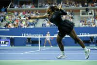 Serena Williams hits a return to Magda Linette (out of frame) of Poland during their 2018 U.S. Open Women's Singles match at the USTA Billie Jean King National Tennis Center.(Eduardo Munoz Alvarez/Agence France-Presse)