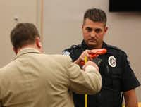 Defense attorney Miles Brissette (left) questions Balch Springs police officer Tyler Gross.(Rose Baca/Staff Photographer)