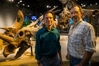 """<p>Paleontologists Tony Fiorillo (left) and Ron Tykoski attended the ribbon-cutting for the new Paleo Lab in the T. Boone Pickens Life Then and Now Hall of the Perot Museum of Nature and Science on Tuesday. Behind them is the horned dinosaur<em style=""""font-size: 1em; background-color: transparent;"""">Pachyrhinosaurus perotorum,</em><span style=""""font-size: 1em; background-color: transparent;""""> a species the team discovered in Alaska.</span></p>(Ryan Michalesko/Staff Photographer)"""