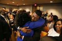 Odell Edwards gets a hug from Dallas County district attorney Faith Johnson following Tuesday's guilty verdict in the murder trial of Roy Oliver, the former Balch Springs police officer who fatally shot Edwards' 15-year-old son, Jordan, last year.(Staff Photographer/Rose Baca)