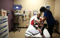 A nurse helps discharge a patient in the emergency department at Parkland Memorial Hospital in Dallas on Friday, Nov. 17, 2017.(2017 File Photo/Rose Baca)
