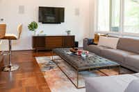 Designer Tara Lenney follows this rule when helping clients select consoles for under a television: The TV should not take up more than two-thirds the width of the console.<div><br></div>(Tara Lenney Design)