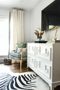 Style a television console with books, personal items and other decorative items to help balance out a television, says designer Abbe Fenimore.(Shayna Fontana)