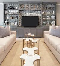 Punch up built-in cabinetry with graphic wallpaper or fabric, suggests Emily Sheehan Hewett of A Well Dressed Home.(A Well Dressed Home)