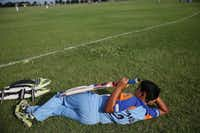 Rahul Jariwala of Freemont, Calif., relaxes before an under-12 match during a Plano cricket match.(File Photo/Staff)