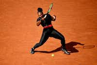 In this file photo taken on May 29, 2018 Serena Williams plays a forehand return to Czech Republic's Kristyna Pliskova during their women's singles first round match on day three of the Roland Garros 2018 French Open tennis tournament in Paris.(Christophe Simon/Agence France-Presse)