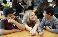 New teacher Caroline Rodgers talks with Brandon Garcia (right) as Brandon Navarr looks on during their 6th grade class at Carolyn G. Bukhair Elementary School, a Richardson Independent School District campus in Dallas on Aug. 20, 2018. Rodgers' grandmother is Carolyn Bukhair, the school's namesake. (Vernon Bryant/Staff Photographer)