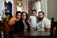Josh Collins and his wife Jessica Salazar Collins were notified by Bank of America that Josh, who was born in Wichita, Kan., had to prove his citizenship. They thought it was a scam until the bank cut off access to their assets. The Collins family (from left) Joshua Collins, Jessica Salazar Collins, Trinidad Collins and Josh Collins, lives in Roeland Park, Kan. (Jill Toyoshiba/TNS)