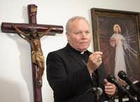 Bishop Edward Burns addressed reporters's questions about Edmundo Paredes during a press conference at St. Cecilia Catholic Church on Aug. 19.(Rex C. Curry/Special Contributor)