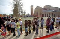 A long line wound around St. Cecilia Catholic Church before the start of 3 p.m. Mass for the dedication of the new building  on Nov. 20, 2011. (Louis DeLuca/Staff Photographer)
