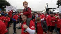 """<p><span style=""""font-size: 1em; background-color: transparent;"""">In this file photo, Luke Hudson and his dad Herman Hudson wait for the Dallas Heart Walk to start.</span></p>(Ron Baselice/Staff Photographer)"""