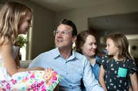 Drew Calver sits with his wife Erin and daughters Eleanor, 7, and Emory, 6, in their home where he had a heart attack April 2, 2017. Mr. Calver, a high school teacher, has good insurance through his employer but his remaining out-of-network bill was $108,951.31.(Callie Richmond)